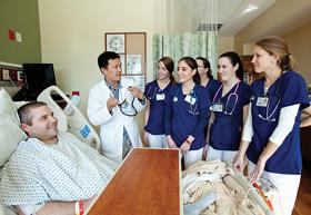 "College of Nursing student Hyochol ""Brian"" Ahn teaches nursing students at Shands at UF"